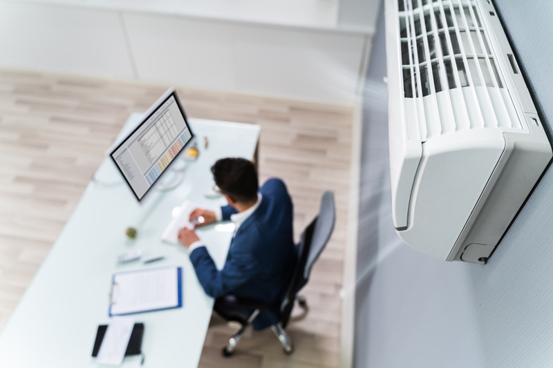 Man working in office with air con