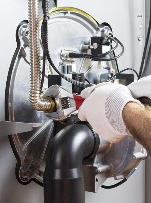 Boiler expert fitting a boiler