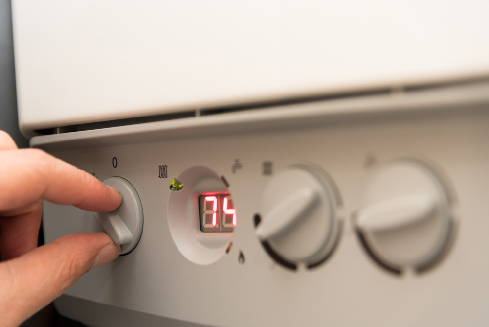 Boiler with person adjusting dials
